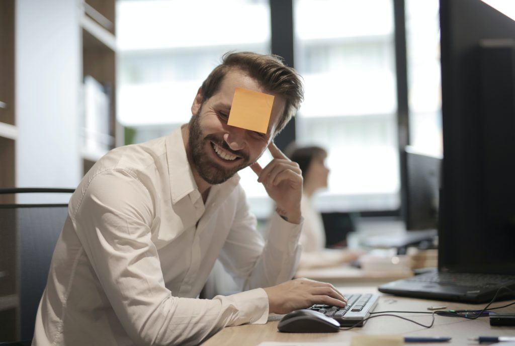 man in white dress shirt with post it note on his forehead 3966800 1